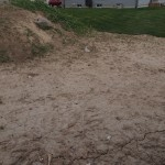 Back yard with heap of topsoil