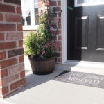 My first container garden for my porch with welcome doormat