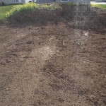 """Half a heap of """"topsoil"""" left in the backyard, the rest of the yard is now graded"""