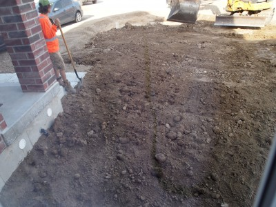 "Spreading ""topsoil"" and widening driveway"