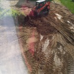 """Getting more """"topsoil"""" to finish grading - view from the bedroom window"""
