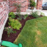 The porch garden with new mulch. You can see the new hosta I bought from Walmart in the corner.